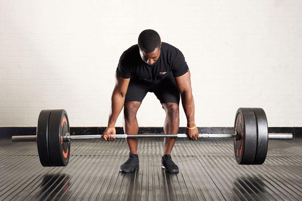 fitness expert performs a romanian deadlift using mirafit gym equipment