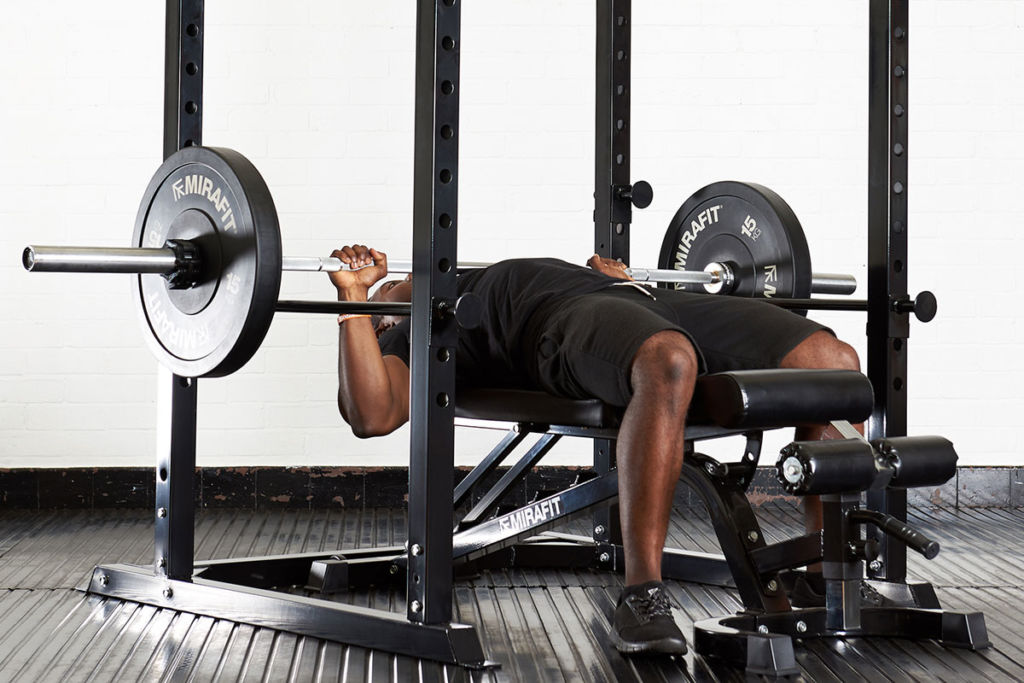 fitness expert uses mirafit power rack for chest workout