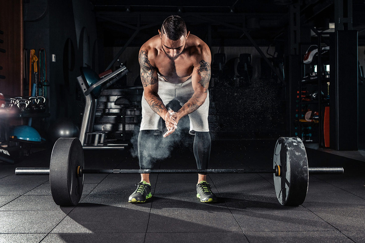 Man-Preparing-To-Do-Deadlifts