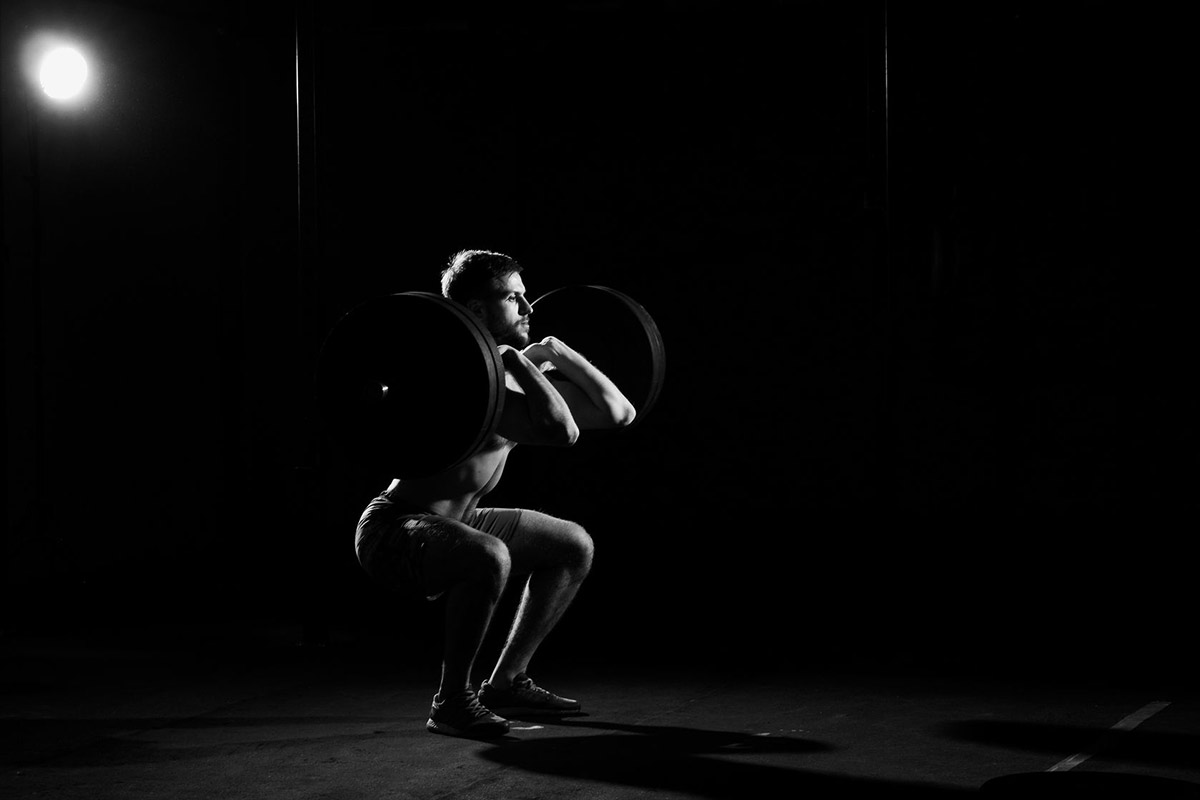 benefits-of-squats-mirafit-blog-man-with-barbell-doing-front-squats