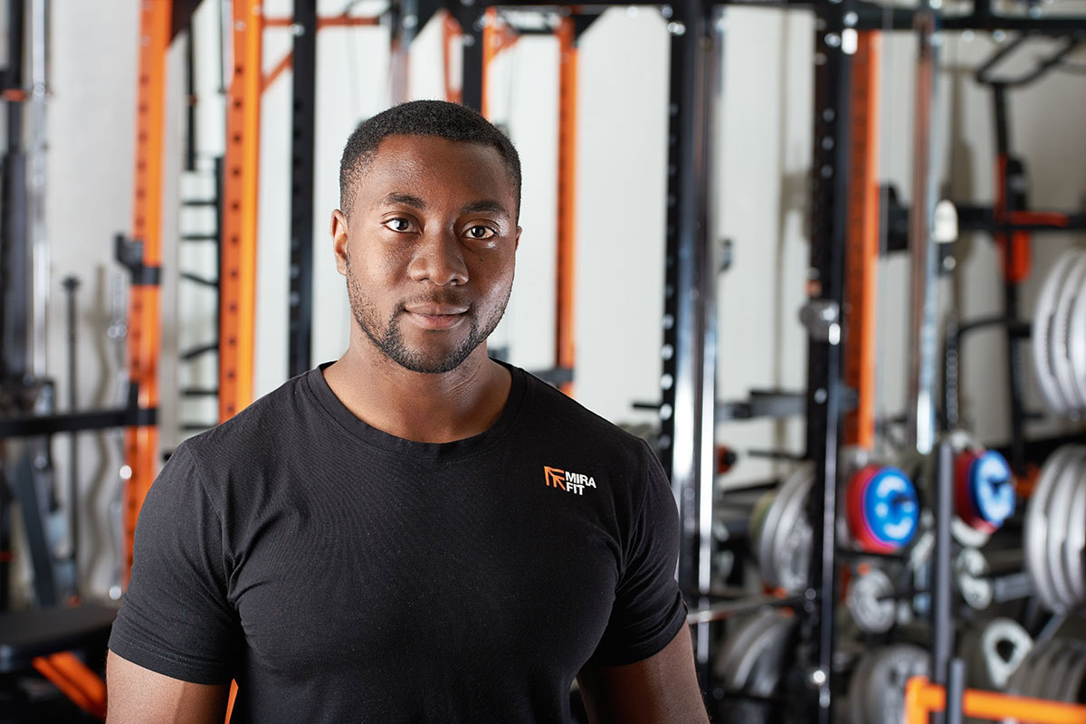 young man in fitness attire posing for a professional head shot