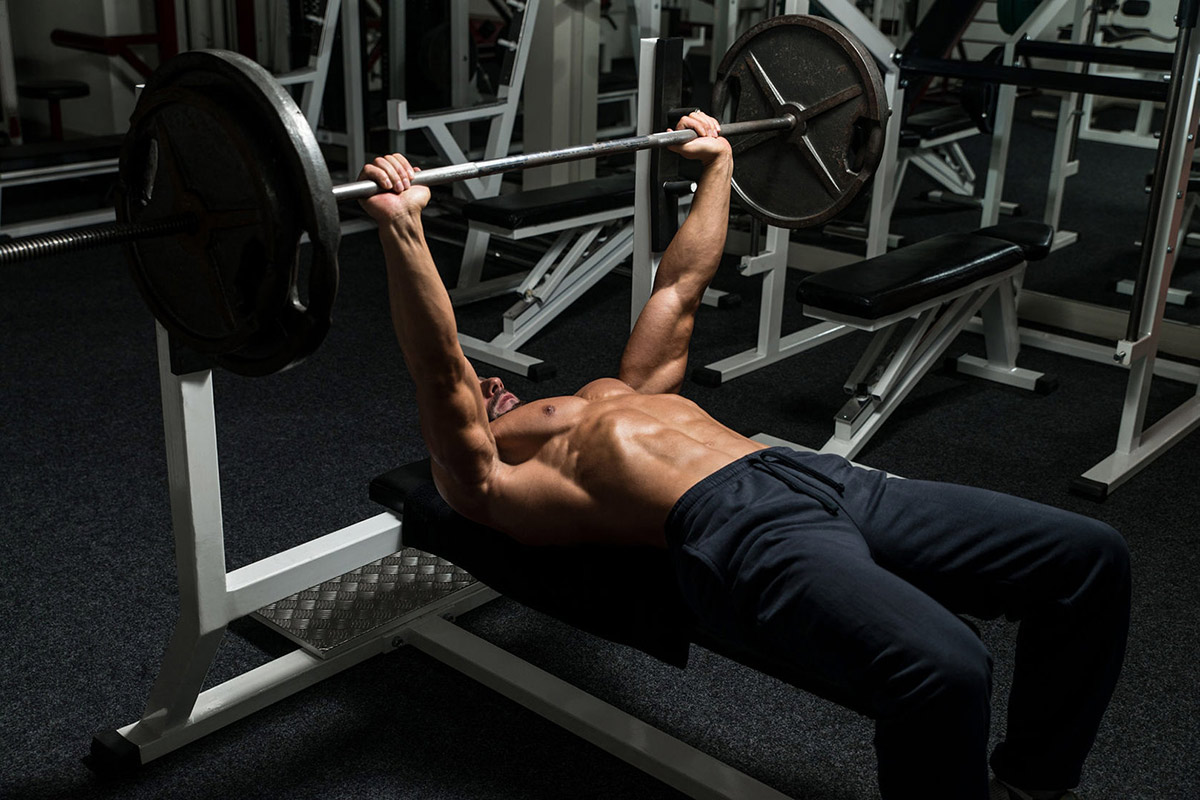 Mirafit-blog-on-how-to-get-stronger-image-of-man-doing-a-bench-press