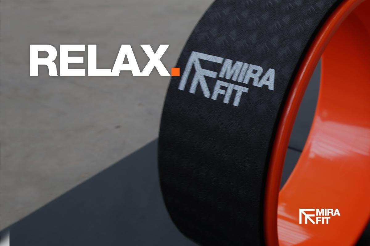 relax without the gym image of orange yoga wheel