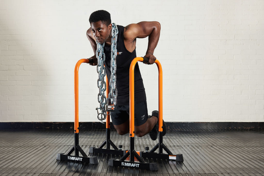 fitness expert doing parallel dips compound exercise