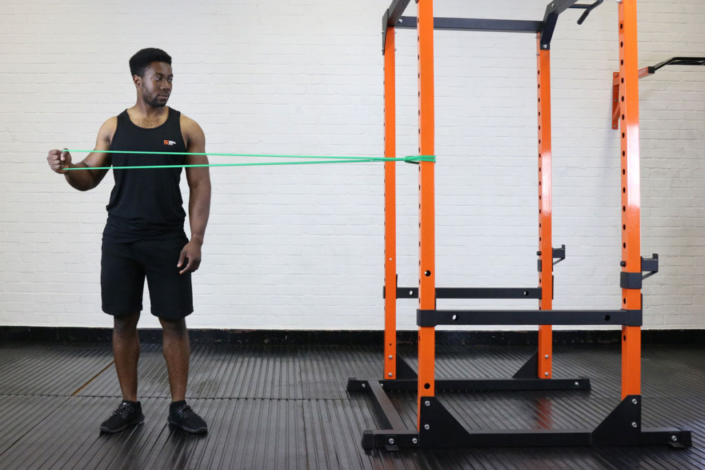 fitness expert uses mirafit resistance band to do lateral external rotations