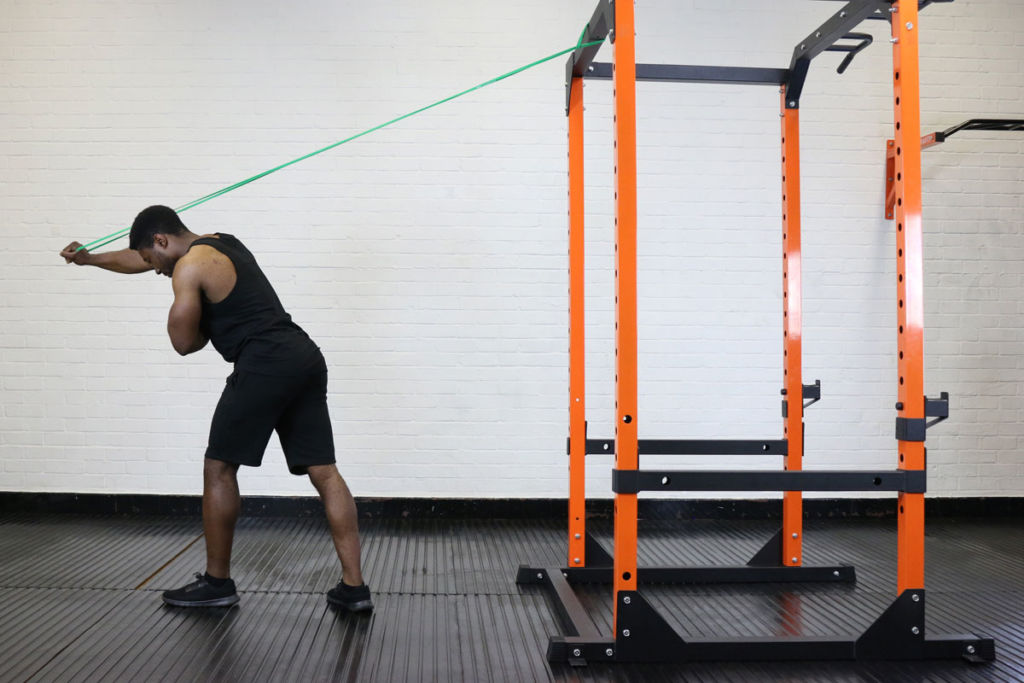 fitness expert uses mirafit resistance band to do tricep extensions