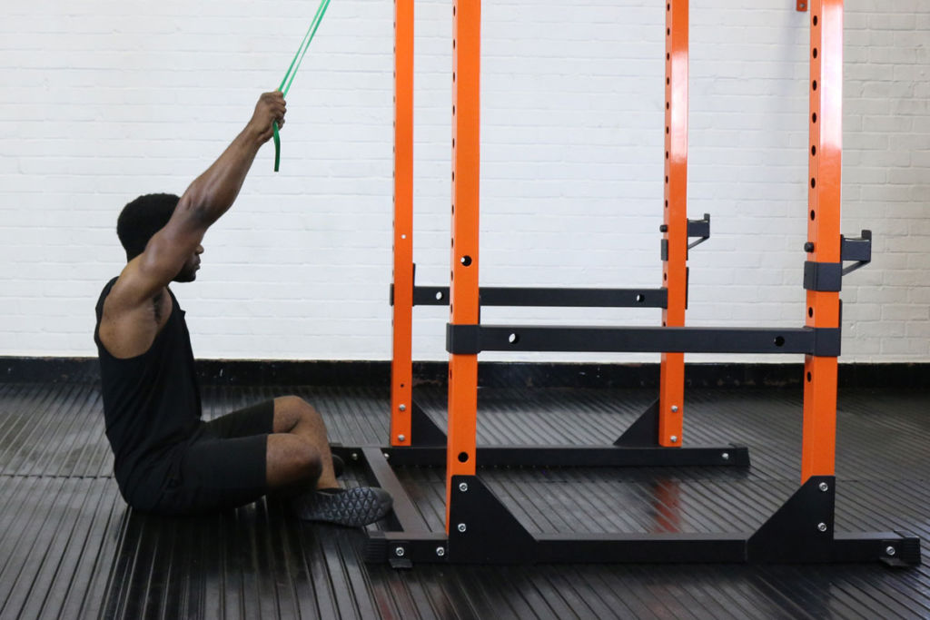 fitness expert uses mirafit resistance band to lat pulldown exercises