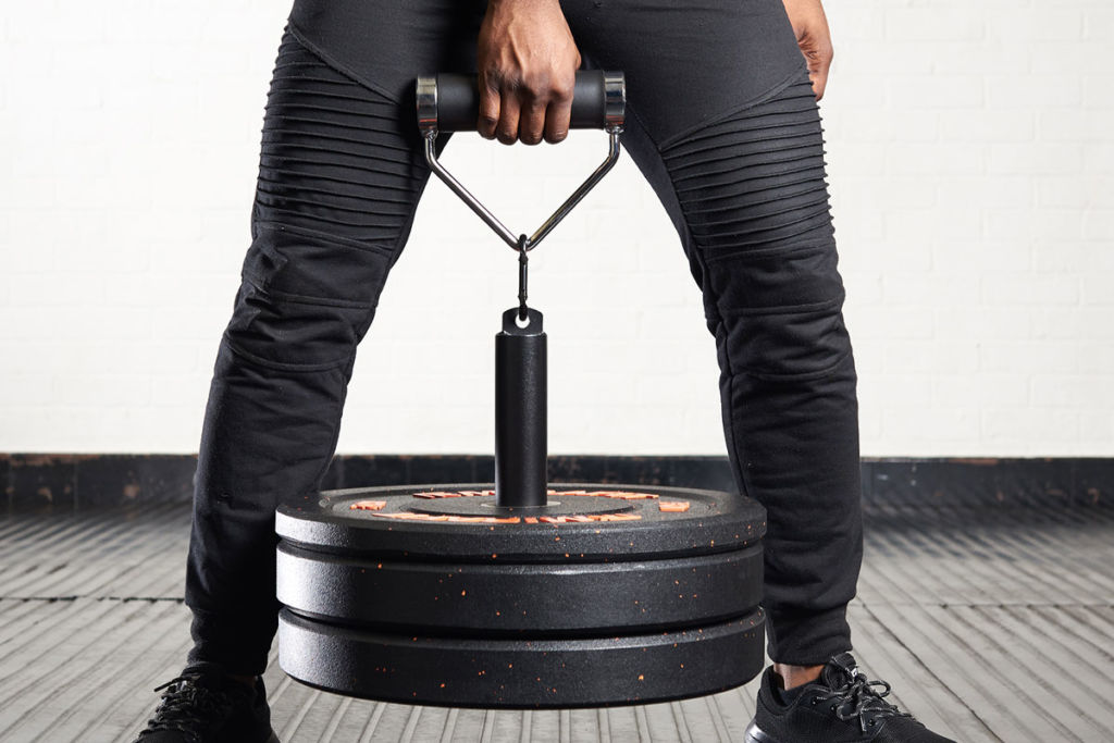 mirafit fitness expert using a loading pin to train