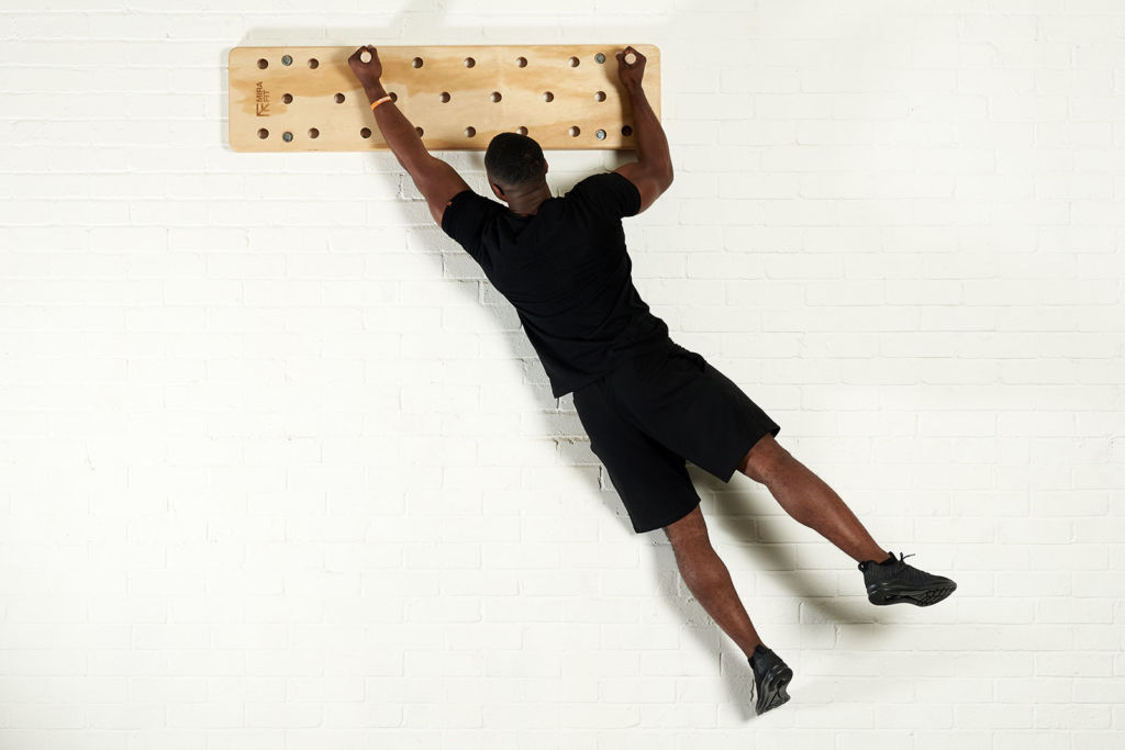 Pegboard mounted directly on the wall for rock and ice climbing training