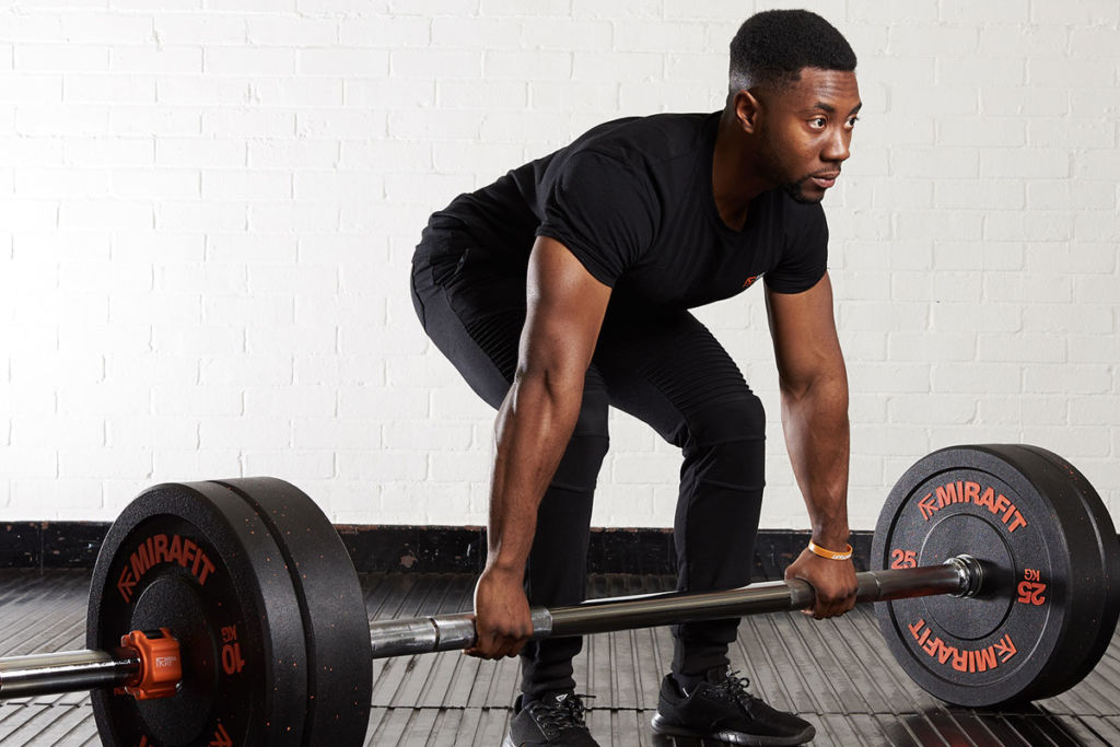 fitness expert uses a thick grip barbell to deadlift