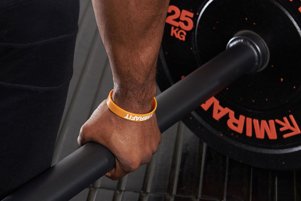 fitness expert uses a thick grip barbell to do deadlifts
