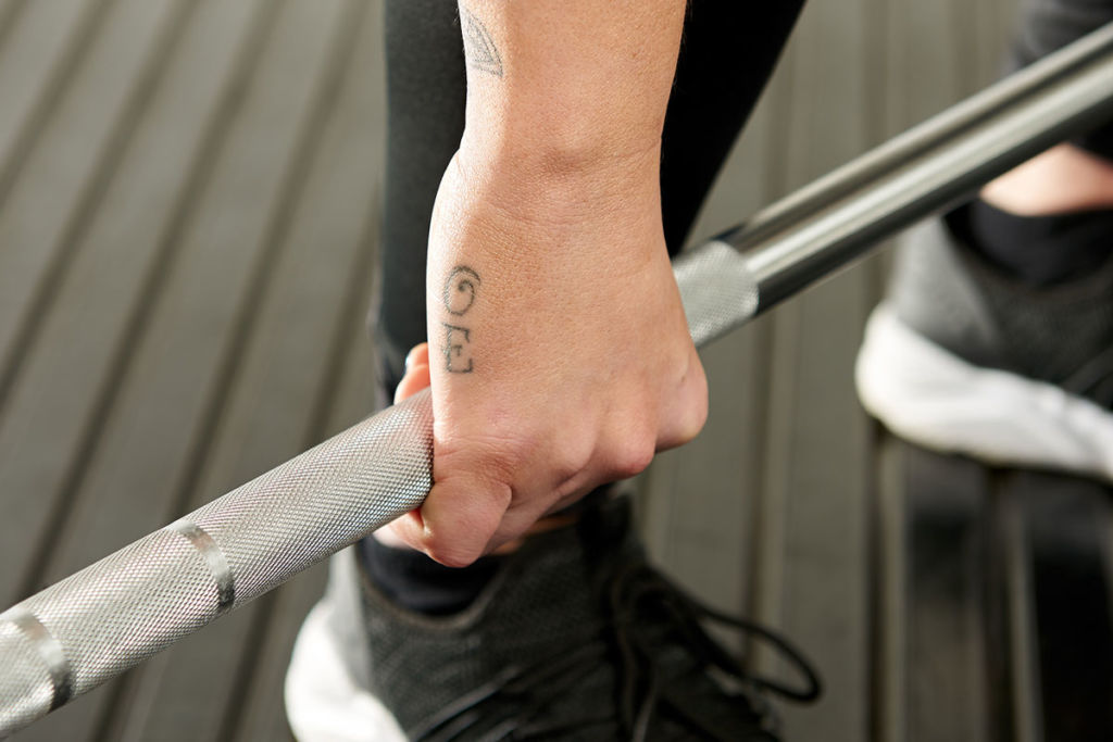 hand on mirafit barbell for doing crossfit exercises