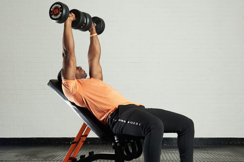 fitness expert on a mirafit weight bench doing incline dumbbell bench press