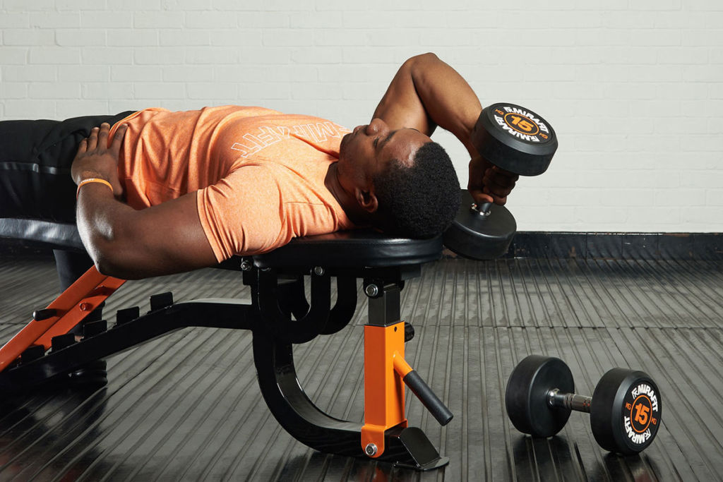 fitness expert on a mirafit weight bench doing lying tricep extensions