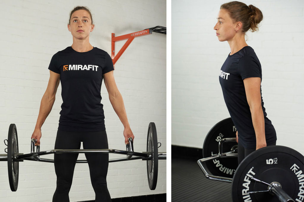 personal trainer performing hex bar deadlift