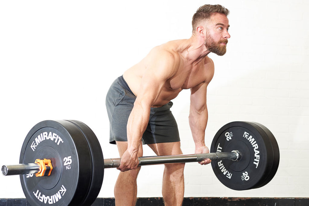 crossfit coach uses mirafit barbell to deadlift