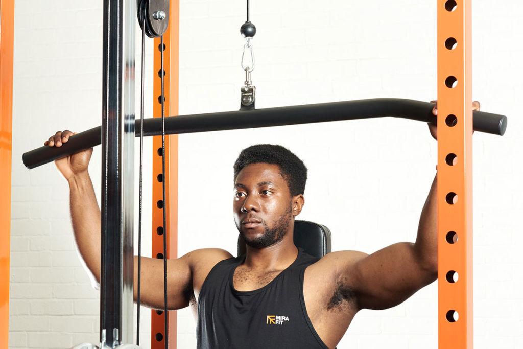 fitness expert uses a mirafit lat pulldown bar
