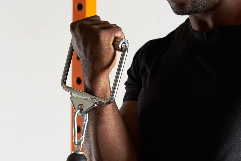 fitness expert uses mirafit stirrup cable attachment