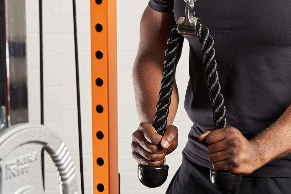 fitness expert uses mirafit tricep rope for pulldown exercises