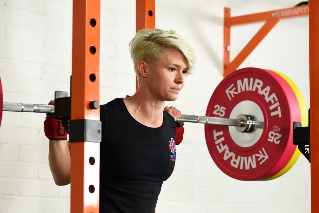 powerlifter jodie cook performing competition squat