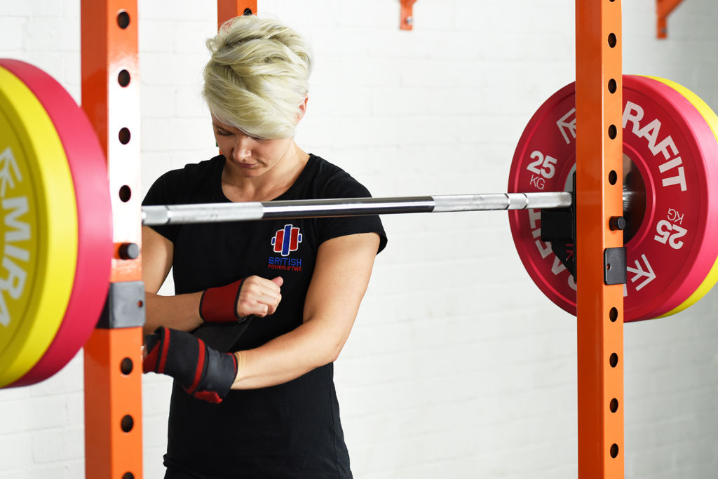 powerlifter jodie cook preparing to squat using mirafit barbell and weights