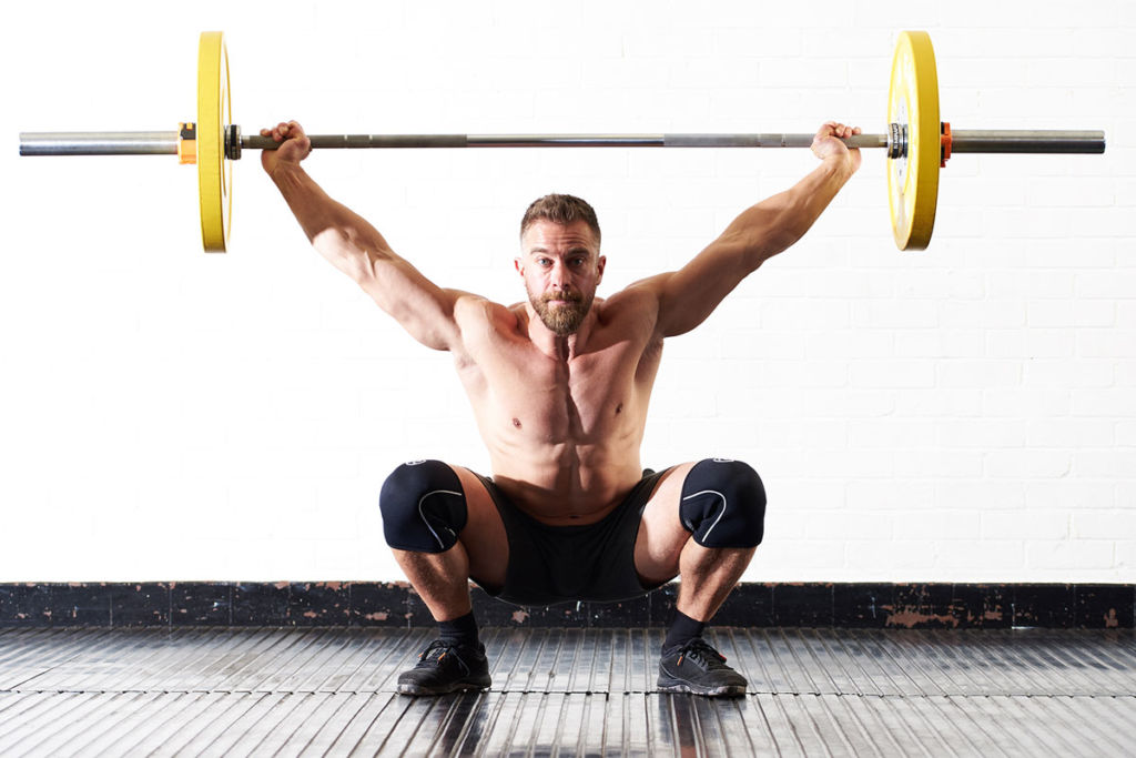 crossfit-coach-doing-snatch-grip-olympic-weightlifting