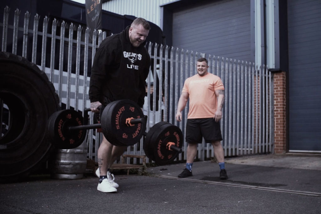 The World's Strongest Brothers Luke and Tom Stoltman performing a strongman farmers walk